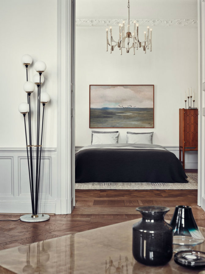 Learn how to use modern floor lamps in a mid-century home Joanna Lavens Stockholm Apartment in Elle Decor, photo by Idha Lindhag