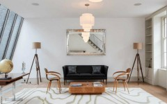 Wooden floor lamps for a mid-century modern home design Eclectic living space with twin tripod floor lamps